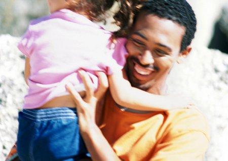 Afrikansk far med barn