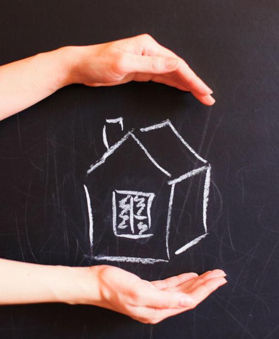 Bilde av hus på tavle