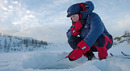 Girl wearing insulating primaloft jacket ice fishing with mormyshka ----Jente med isolerende jakke i primaloft fisker p isen med mormyshka