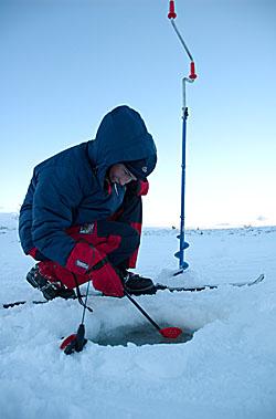 Girl ice fishing a cold december day----Jente fisker p� isen en kald ettermiddag i desember