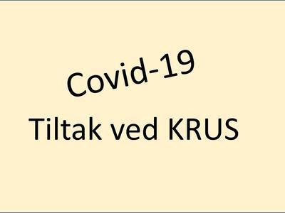 Covid-19. Tiltak ved KRUS. Tekst på ensfarget flate som illustrasjon.